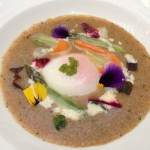 Amaranth with vegetables and poached egg
